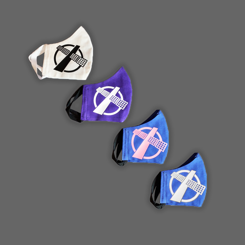 four colors of masks with the Satellite Gaming logo on them, white, purple, navy (with pink) and navy (with white)